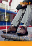Timberland ad - travelling man with shoes on bench at Canary Wharf